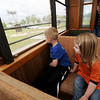 Oliver Thompson, 6 and Lucy Thompson, 3, enjoy a ride on the 60 Trolley as Lee Englert mans the controls on Tuesday at the Webb City Farmers Market. Tuesday marked the first time in three years the 1916 trolley has run. The trolley was formerly a chicken coop in south Joplin before the Southwest Missouri Electric Railroad Association acquired it in the late 1970s.