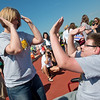Globe/Roger Nomer<br /> Desiree Corn gives Austin Holt, Cassville, a high five after his competition during Friday's Southwest Area Special Olympics Spring Games at Carl Junction High School.