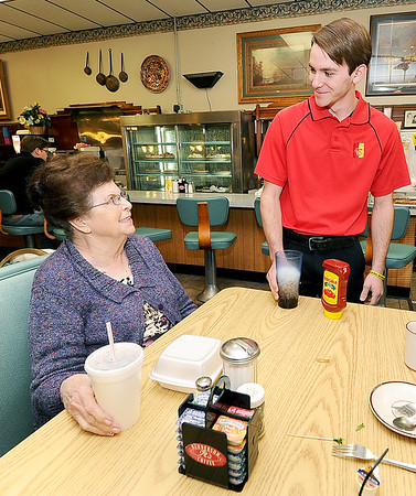 NIneteen-year-old entrepeneur Andrew Faucett chats with Harry's Cafe regular Shirley Herford inside the cafe on Friday in downtown Pittsburg.<br /> Globe | Laurie Sisk