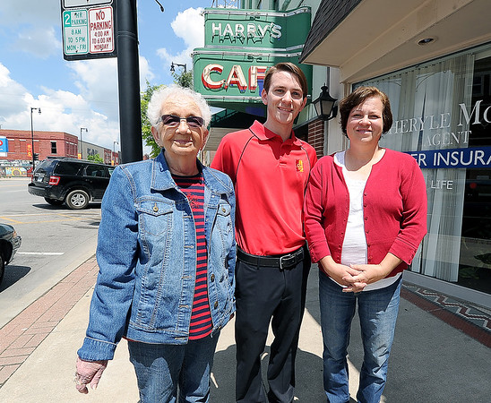 NIneteen-year-old entrepeneur Andrew Faucett, center stands outside with Harry's Cafe owner Betty Farris, left and Kimbra Brunk, former owner of Girard's Peppermill Cafe on Friday in downtown Pittsburg. In the next few weeks, Faucett plans to open his own restaurant, The Eastside Cafe in Girard at the sire of the Peppermill Cafe.<br /> Globe | Laurie Sisk