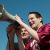 Globe/Roger Nomer<br /> Karl Hembree, Joplin, helps volunteer David Thompson announce the winners during Friday's Southwest Area Special Olympics Spring Games at Carl Junction High School.