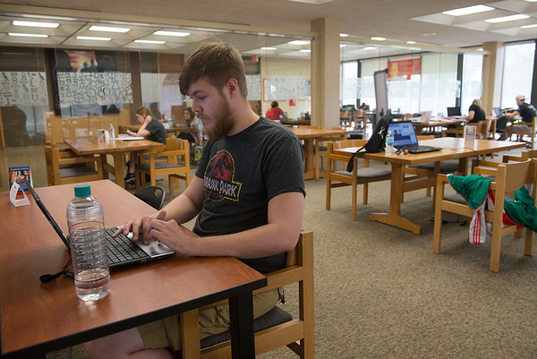 Globe/Roger Nomer<br /> Devin Fitzgerald, a Pittsburg State sophomore from Ellsworth, Kan., studies on Monday at Axe Library.
