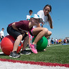 Globe/Roger Nomer<br /> Easton Creekmore, 6, Wheaton, races Ashley Gilion, a Missouri Southern senior from Neosho, during Friday's Southwest Area Special Olympics Spring Games at Carl Junction High School.