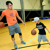 Boys and Girls Club Wellness Coordinator Will Porter helps seven-year-old Cortez Canterbury with his ball handling skills during the afterschool program on Thursday at the club.<br /> Globe | Laurie Sisk