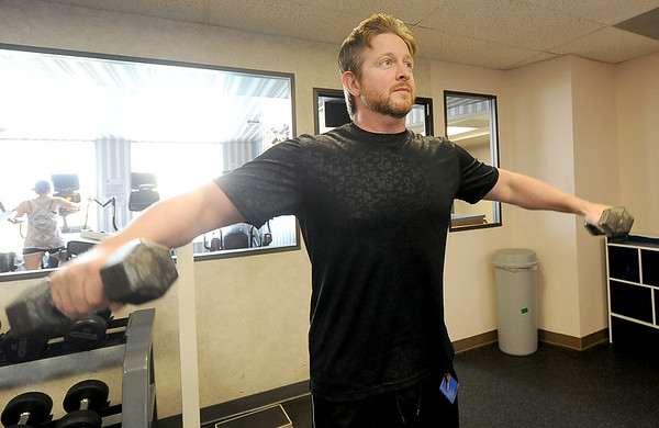 Tom Carlton warms up for his workout at the Downtown YMCA on Tuesday.<br /> Globe | Laurie Sisk