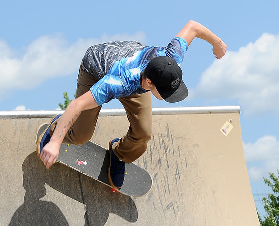 Jamie Evans takes advantage of beautiful weather as he hones his skills at the Ewert Skate Park on Tuesday.<br /> Globe   Laurie Sisk