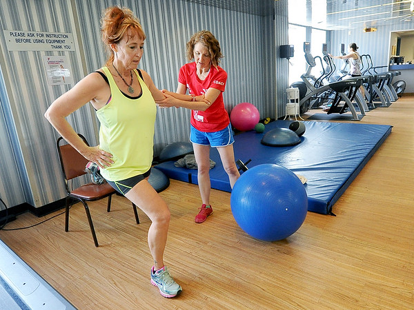 From the left: Leigh Kelley works out with YMCA Running Coach Karen King at the Downtown YMCA on Tuesday.<br /> Globe | Laurie Sisk