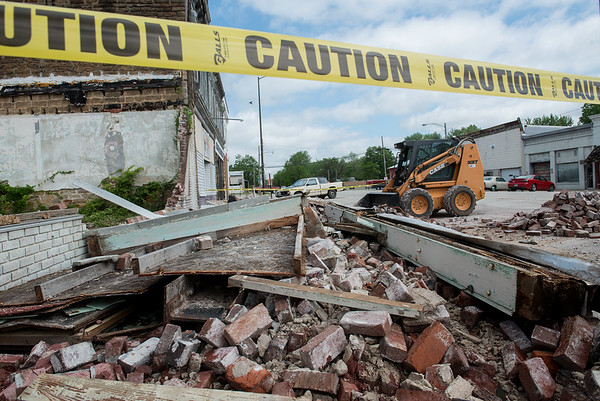 Globe/Roger Nomer<br /> Strong winds toppled a brick building in Liberal on Wednesday morning.