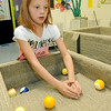 Eight-year-old Jesslynn Ugalde plays a game of carpetball with friends during the afterschool program on Thursday at the club.<br /> Globe | Laurie Sisk
