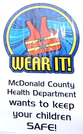 Signs from the McDonald County Health Department are scattered around the county reminding water lovers to wear lifevests while boating and canoeing.<br /> Globe | Laurie Sisk