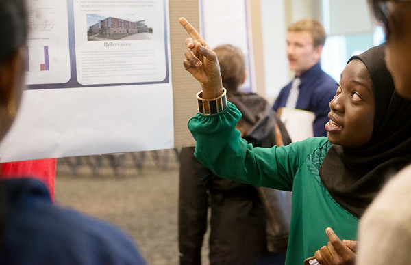 Globe/Roger Nomer<br /> Kauta Suso, a Missouri Southern senior from Gambia, talks about her project on influenza on Thursday at the Research Fair.