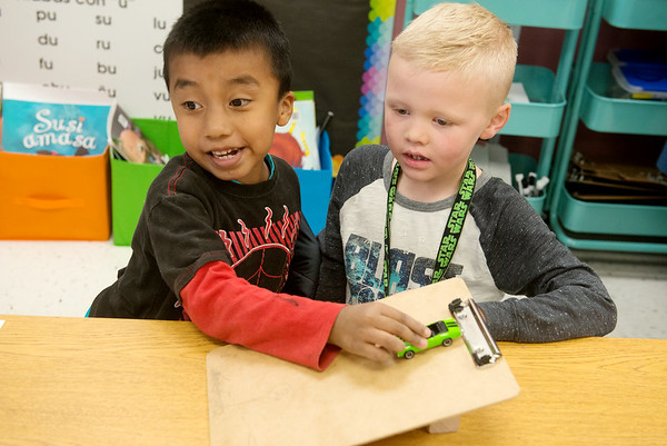 Globe/Roger Nomer<br /> Kindergarteners Jossen Alvarado, left, and Jack Dally experiment with ramps during a science lesson conducted in Spanish on Monday at Fairview Elementary.