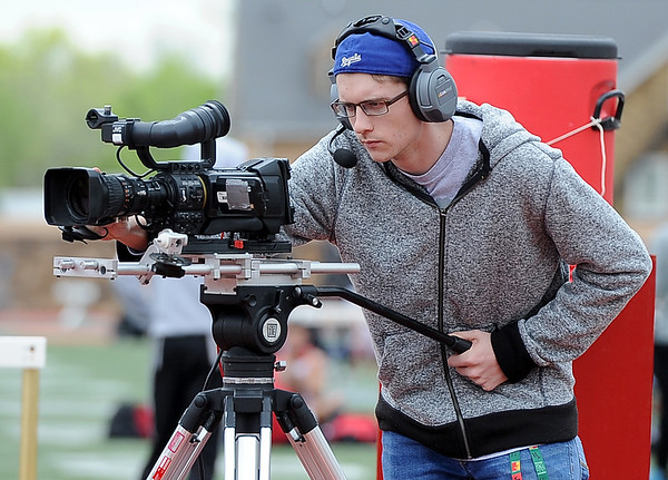 Pittsburg State CAPS13 videographer Cameron Molina keeps a keen eye on the action as he supplies live a video feed for the jumbotron at Carnie Smith Stadium during the 8th Annual David Suenram Gorilla Classic on Saturday at Pittsburg State University.<br /> Globe | Laurie Sisk
