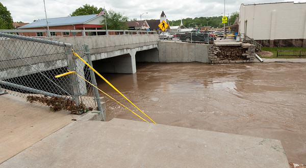 The pedestrian bridge over Lost Creek is absent after flood waters washed it about 60 yards downstream after heavy flooding this weekend.<br /> Globe | Laurie Sisk