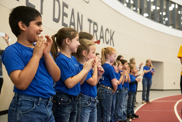 Globe/Roger Nomer<br /> Students from St. Mary's School in Fort Scott line the track to cheer on their principal's son during Thursday's Kansas Southeast Region Special Olympics Spring Games at Pittsburg State's Plaster Center.