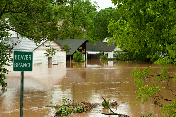 Homes and businesses remain partially underwater Saturday in Anderson after heavy rains Friday night and Saturday caused massive flooding in the area.<br /> Globe | Laurie Sisk