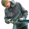 Joseph Jasper, 13, scraps old paint off a set of bleachers at the Little League stadium at Landreth Park on Saturday.<br /> Globe | Laurie Sisk