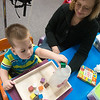 Globe/Roger Nomer<br /> Shelly Kelling, special instructor, works with Loyde Ballard, Jr., 2, on Wednesday at the Cerebrap Palsy of Tri-County center in Webb City.