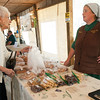 From the left: Lorraine Johnson, of Joplin, chats with Mabel Brubaker, of Wentworth Baked Goods  on Thursday afternoon at the Webb City Farmers Market. The market is open of Tuesdays, Thursdays and Saturdays.<br /> Globe | Laurie Sisk