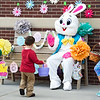 Three-year-old Jimmy Mays gets a high-five from the Easter Bunny as his brother, John Mays, 9, looks on during an Easter Egg Hunt and Open House on Saturday at St. Mary Elementary. Also pictured is Easter Bunny assistant Jadyn LaFerla.<br /> Globe | Laurie Sisk