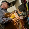 Globe/Roger Nomer<br /> Paul Brown grinds a knife edge while working on Friday in his Carthage studio.