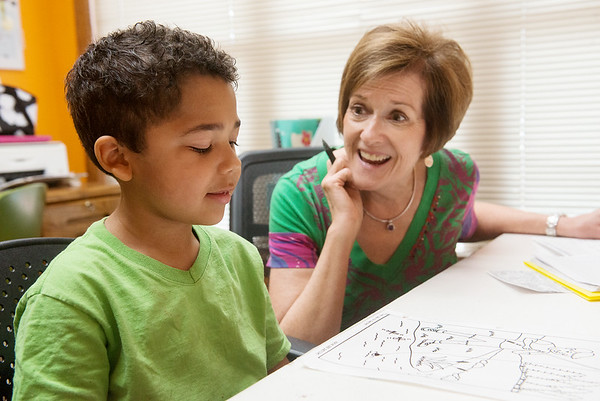 Globe/Roger Nomer<br /> Martha Waugh, speech and language pathologist, works with Latrell Johnson, 5, on Wednesday at the Cerebrap Palsy of Tri-County center in Webb City.