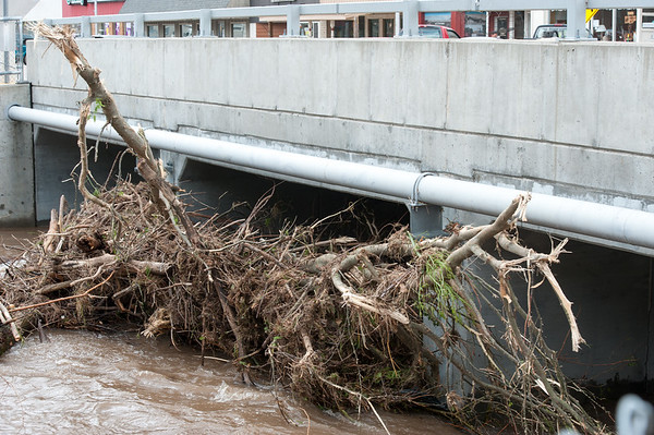 Debris clogs the Lost Creek bridge in downtown Seneca after heavy weekend flooding.<br /> Globe | Laurie Sisk