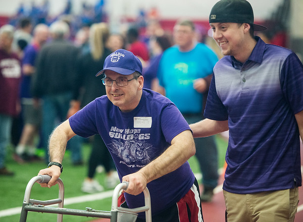 Globe/Roger Nomer<br /> Patrick Thornton, Pittsburg, left, competes in a race accompanied by Austin Koontz during Thursday's Kansas Southeast Region Special Olympics Spring Games at Pittsburg State's Plaster Center.