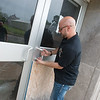 Globe/Roger Nomer<br /> Aaron Garcia, president of SOS Ministries, opens the front door of Washington Education Center on Tuesday.