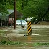 A car and residencelay in flood water Wood Street and La-Z-Boy Drive on Saturday checks out a large chunk of Hwy NN near Anderson that collapsed after heavy rains Friday night and Saturday caused massive flooding in the area.<br /> Globe | Laurie Sisk