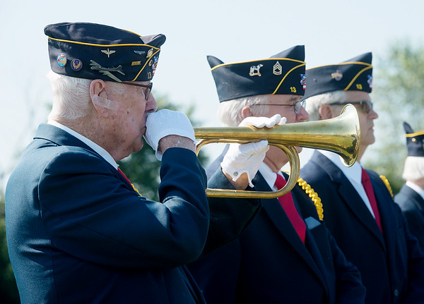 Globe/Roger Nomer<br /> Ken LaNear, the bugler for the Robert Thurman American Legion Post, performs for a funeral in Diamond on June 21, 2016.
