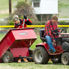 From the left: Ashton and Eli Ventura spread fresh dirt on the infield at the Little League stadium at Landreth Park on Saturday.<br /> Globe | Laurie Sisk