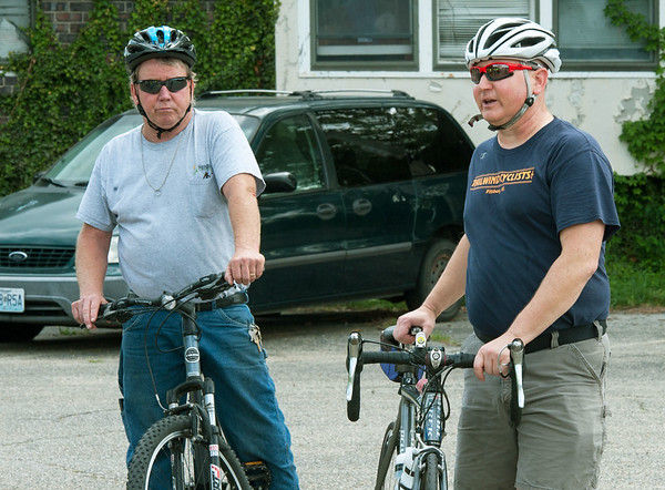 From the left: City of Pittsburg Street Superintendent Lonnie Wells and Roger Lomshek, of Tailwind Cyclists, prepare to head out with officials from the City of Pittsburg, Crawford County and local residents for a bike tour of Pittsburg on Tuesday afternoon. The tour highlighted the challenges of riding a bike through the city.<br /> Globe | Laurie Sisk