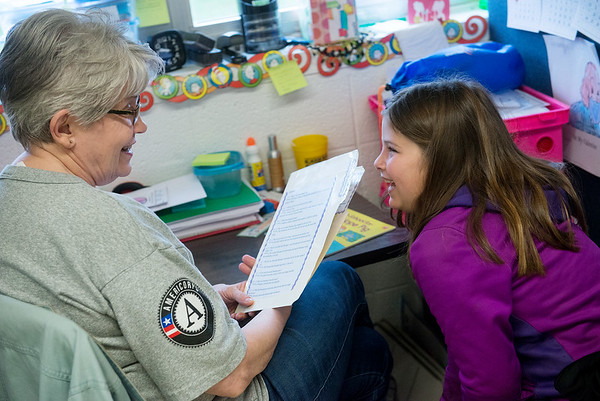 Globe/Roger Nomer<br /> Jana Larmer helps Myranda Robertson, second grade, with her reading skills on Monday at Purdy Elementary.