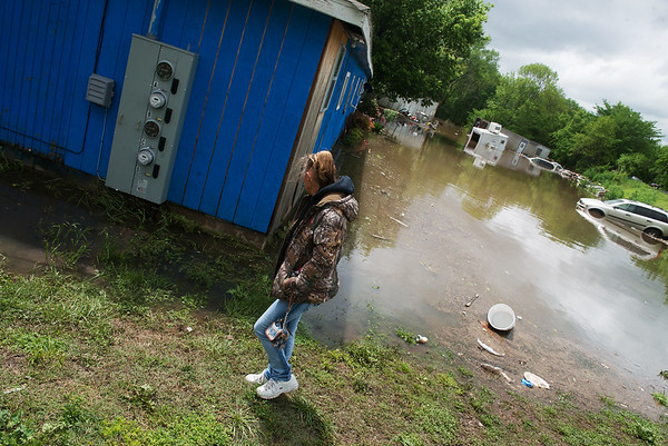 Globe/Roger Nomer<br /> Lora West checks out flooding in Kendricktown on Sunday afternoon.