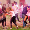 Pittsburg State students and guests on Saturday throw colored powder in recognition of Holi, a Hindu Festival celebrating the triumph of good over evil. The event, sponsored by PSU's Indian Student Assocaition, also featured dancing and water balloons. <br /> Globe | Laurie Sisk