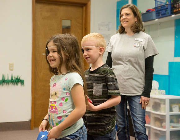 Globe/Roger Nomer<br /> Tiffany Wright helps Purdy kindergartners Addison Arivett and Raylen Patton on Monday with an eye-tracking exercise.
