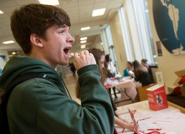 Globe/Roger Nomer<br /> Max Boemmerkamp, a Missouri Southern junior from Carl Junction, swabs his cheek to be registered as a donor during a bone marrow screening event on Tuesday at MSSU. The event was held by MSSU's Caduceus Club.