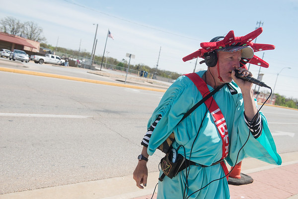 Globe/Roger Nomer<br /> Danny Perkins sings to bring in traffic to Liberty Tax Service on Main Street on Tuesday.