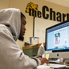 Globe/Roger Nomer<br /> Kelvin Duley II, junior sports editor at The Chart, finishes a sports page on Thursday.