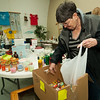 Sheila McReynolds shops for trinkets for a fish pond for the upcoming First United Methodist Church Carnival while at the South Joplin Christian Church's Spring Fever Super Sale on Saturday at the church. Proceeds from the event will benefit the church's mission to help Rowlett, Texas' tornado recovery efforts.<br /> Globe | Laurie Sisk