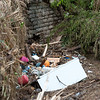 Debris, including a large refrigerator, lay washed up under a bridge in downtown Anderson on Sunday.<br /> Globe | Laurie Sisk