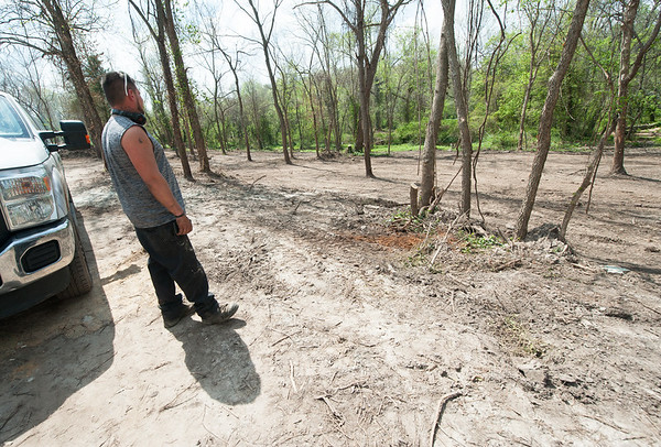 LAndscape Supervisor Homer Culler stands near several acres that have been cleared for development and renovation on the former site of the Redings Mill Pool and Arde's Villa in Redings Mill. A developer has begun reviving the property for future use.<br /> Globe | Laurie SIsk