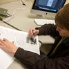 Globe/Roger Nomer<br /> Jack Girard, junior managing editor at The Chart, proofs a page on Thursday.