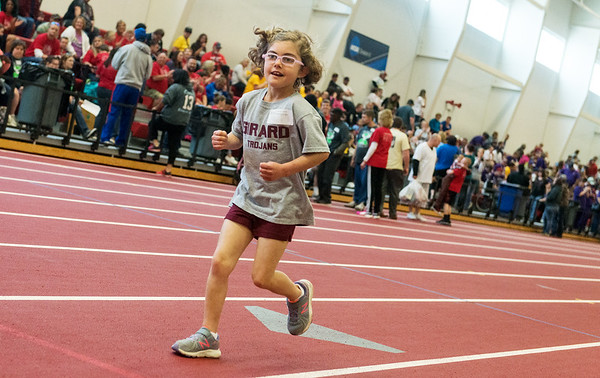 Globe/Roger Nomer<br /> Myah Norton, 8, Girard, heads towards the finish line during Thursday's Kansas Southeast Region Special Olympics Spring Games at Pittsburg State's Plaster Center.