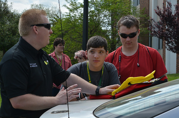 Globe/Sierra Gray<br /> Chad Williams, Missouri Southern EMS instructor, talks to high school sophomore students Michael Pittman, Carl Junction, and Matt Barnhart, Joplin on Wednesday during Sophomore day on MSSU's campus. Missouri Southern welcomed about 2,500 sophomore students from area high schools to tour the campus.