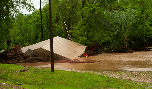 A building lay collapsed oin flood waters near 7th and Park streets in Anderson on Saturday.<br /> Globe | Laurie Sisk