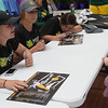 Globe/Roger Nomer<br /> Shaylyn Johnson, 5, Joplin, gets an autograph from Missouri Southern softball players (from left) Angel Badalamenti, Elizabeth Windsor and Erika Lutgen during an appearance on Monday at the Webb City Walmart.