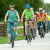 Officials from the City of Pittsburg, Crawford County and local residents make their way through Schlanger Park during a bike tour of Pittsburg on Tuesday afternoon. The tour highlighted the challenges of riding a bike through the city.<br /> Globe | Laurie Sisk