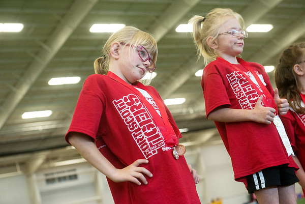 Globe/Roger Nomer<br /> Sisters Julia, left, and Haley Maloun, 9, pose with attitude on the medal stand during Thursday's Kansas Southeast Region Special Olympics Spring Games at Pittsburg State's Plaster Center.